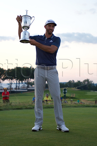19.06.2016. Pittsburgh, PA,USA.   Dustin Johnson celebrates with the winner's trophy after winning the US Open at Oakmont Country Club in Pittsburgh, PA.