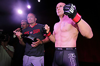 George St-Pierre pose for photographer with his wax replica at Montreal's Grevin Museum, July2, 2014