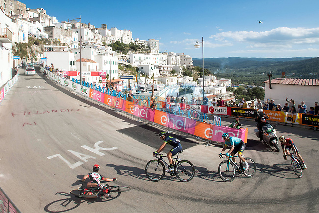 Valerio Conti (ITA) UAE Team Emirates slips on one of the final corners allowing Gorka Izaguirre (ESP) Movistar Team, Luis Leon Sanchez (ESP) Astana and Giovanni Visconti (ITA) Bahrain-Merida to battle it out near the end of Stage 8 of the 100th edition of the Giro d'Italia 2017, running 189km from Molfetta to Peschici, Italy. 1th May 2017.<br /> Picture: LaPresse/Massimo Paolone | Cyclefile<br /> <br /> <br /> All photos usage must carry mandatory copyright credit (&copy; Cyclefile | LaPresse/Massimo Paolone)