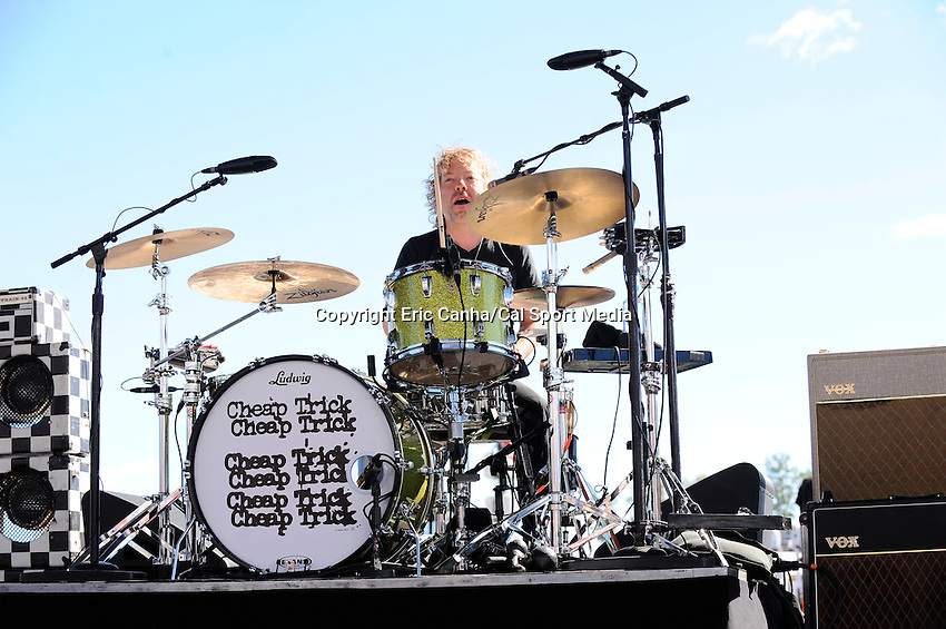 Sunday, September 25, 2016: Daxx Nielsen plays drums with Cheap Trick for spectators before the NASCAR Sprint Cup Series Bad Boy Off Road 300 race held at the New Hampshire Motor Speedway in Loudon, New Hampshire. Sprint Cup Series driver Kevin Harvick (4) won the race. Eric Canha/CSM