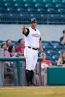 Arkansas Travelers coach Eddie Menchaca (14) during a game against the Frisco RoughRiders on May 26, 2017 at Dickey-Stephens Park in Little Rock, Arkansas.  Arkansas defeated Frisco 4-2.  (Mike Janes/Four Seam Images)