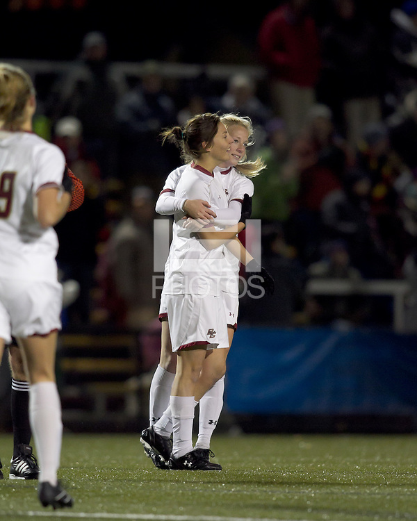"""Boston College forward Victoria DiMartino (1) celebrates her goal with teammates. Boston College defeated West Virginia, 4-0, in NCAA tournament """"Sweet 16"""" match at Newton Soccer Field, Newton, MA."""