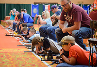 NWA Democrat-Gazette/CHARLIE KAIJO Young competitors finish the prone position shooting event during the 2018 annual Daisy National BB Gun Championship, Monday, July 2, 2018 at the John Q. Hammons Center in Rogers. <br />