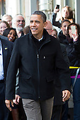 "United States President Barack Obama greets onlookers after shopping at One More Page Books in Arlington, Virginia on Small Business Saturday, November 24, 2012, with his daughters, Sasha and Malia. .Credit: Kristoffer Tripplaar  / Pool via CNP..Pool Report 1: Motorcade left the South Lawn [of the White House] at 1:02 p.m. and arrived in Arlington, Virginia, at One More Page Books at 1:15 p.m. for an OTR (Off the Record) Small Business Saturday event with Sasha and Malia.  From the door of the small book shop, which the White House described as an ""independent, neighborhood bookstore,"" POTUS (President of the United States) could be seen holding up his BlackBerry, apparently looking up a title, as he spoke with shop owner Eileen McGervey. ""Preparation,"" the president said. ""That's how I shop.""  Wearing a dark windbreaker against the blustery weather outside, POTUS handed off a stack of about 10 books to the clerk -- pool was too far away to read titles -- (will send in a later report if we get them) and then shook hands with several employees. He then began to wander through the business with his daughters as pool was escorted out.  ""We're doing Christmas shopping,"" POTUS said to a question from the pool about the fiscal cliff. ""Happy Thanksgiving, folks.""  POTUS emerged about 10 minutes later to shake hands for a few minutes with two small groups that formed outside the shop on the sidewalk."