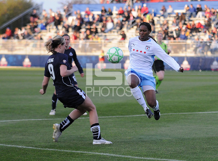 Chicago Red Stars defender Ifeoma Dieke (4) kicks the ball to defend the play agaisnt Washington Freedom midfielder Allie Long (9) Washington Freedom tied Chicago Red Stars 1-1  at The Maryland SoccerPlex, Saturday April 11, 2009.