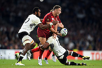 Sam Burgess of England offloads the ball after being tackled by Gabiriele Lovobalavu of Fiji. Rugby World Cup Pool A match between England and Fiji on September 18, 2015 at Twickenham Stadium in London, England. Photo by: Patrick Khachfe / Onside Images