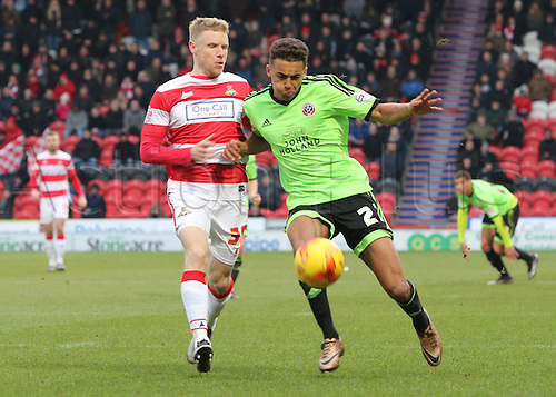 13.02.2016. Keepmoat Stadium, Doncaster, England. Skybet League One. Doncasters Craig Alcock and Sheffield Uniteds Dominic Calvert-Lewin chase down the loose ball