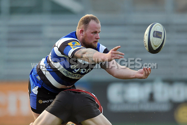 Jake Caulfield of Bath United passes the ball. End-of-season friendly match, between Bath United and Somerset County Senior XV on April 20, 2015 at the Recreation Ground in Bath, England. Photo by: Patrick Khachfe / Onside Images