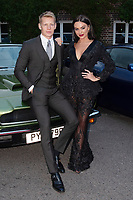 Charlie Frederick and Rosie Williams at the Grand Prix Ball at the Hurlingham Club, London on July 4th 2018<br /> CAP/ROS<br /> &copy;ROS/Capital Pictures