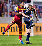 Real Salt Lake defender Jamison Olave (4) and Philadelphia Union forward Fernando Aristeguieta (18) head the ball in the second half Saturday, March 14, 2015, during the Major League Soccer game at Rio Tiinto Stadium in Sandy, Utah. (© 2015 Douglas C. Pizac)