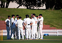 The Firebirds huddle on day two of the Plunket Shield cricket match between the Wellington Firebirds and Otago Volts at the Hawkins Basin Reserve in Wellington, New Zealand on Tuesday, 31 October 2017. Photo: Dave Lintott / lintottphoto.co.nz