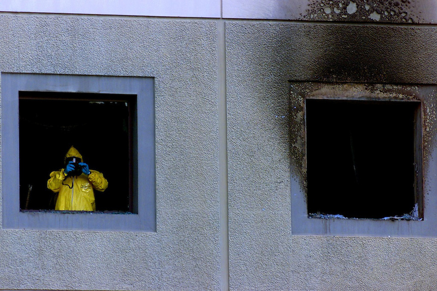 UC Irvine--A member of the UCLA HAZMAT response team photographs inside the Frederick Reines Hall where a fire broke out in one of the chemistry labs.