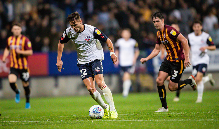 Bolton Wanderers' Dennis Politic btreaks away from Bradford City's Jackson Longridge (right) <br /> <br /> Photographer Andrew Kearns/CameraSport<br /> <br /> EFL Leasing.com Trophy - Northern Section - Group F - Bolton Wanderers v Bradford City -  Tuesday 3rd September 2019 - University of Bolton Stadium - Bolton<br />  <br /> World Copyright © 2018 CameraSport. All rights reserved. 43 Linden Ave. Countesthorpe. Leicester. England. LE8 5PG - Tel: +44 (0) 116 277 4147 - admin@camerasport.com - www.camerasport.com