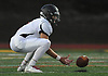 Frank Vano #2 of Babylon fields a punt during a Suffolk County Division IV varsity football game against host Shoreham-Wading River High School on Friday, Oct. 20, 2017.
