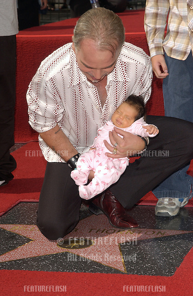 Actor BILLY BOB THORNTON with his two-week-old daughter BELLA at ceremony on Hollywood Boulevard where he was honored with the 2,265th star on the Hollywood Walk of Fame..October 7, 2004