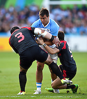 Facundo Isa of Argentina is tackled by Davit Zirakashvili and Vasil Lobzhanidze of Georgia. Rugby World Cup Pool C match between Argentina and Georgia on September 25, 2015 at Kingsholm Stadium in Gloucester, England. Photo by: Patrick Khachfe / Onside Images