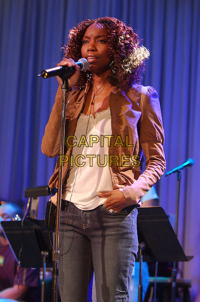 HEATHER HEADLEY .2006 Clive Davis Party Sound Check and Reception sponsored by L'Oreal, Rhapsody, and XM Satellite Radio held at the Beverly Hilton Hotel, Beverly Hills, California, USA..February 6th, 2006.Photo: Laura Farr/AdMedia/Capital Pictures.Ref: LF/ADM.half length singing music microphone brown jacket.www.capitalpictures.com.sales@capitalpictures.com.© Capital Pictures.