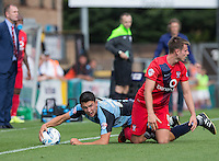 Luke O'Nien of Wycombe Wanderers grabs at the ball after being brought down by James Berrett of York City during the Sky Bet League 2 match between Wycombe Wanderers and York City at Adams Park, High Wycombe, England on 8 August 2015. Photo by Andy Rowland.