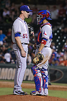 Scott Richmond (55) and Robinson Chirinos (14) of the Round Rock Express talk on the mound during the Pacific Coast League game against the Oklahoma City RedHawks at Chickashaw Bricktown Ballpark on June 14, 2013 in Oklahoma City ,Oklahoma.  (William Purnell/Four Seam Images)