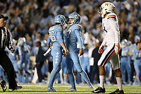 CHAPEL HILL, NC - NOVEMBER 02: Noah Ruggles #97 and Cooper Graham #96 of the University of North Carolina celebrate a field goal during a game between University of Virginia and University of North Carolina at Kenan Memorial Stadium on November 02, 2019 in Chapel Hill, North Carolina.