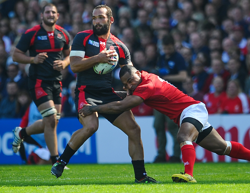 Georgia's Tamaz Mchedlidze is tackled by Tonga's Telusa Veainu<br /> <br /> Photographer Craig Thomas/CameraSport<br /> <br /> Rugby Union - 2015 Rugby World Cup - 12;00  Georgia v Tonga - Saturday 19th September 2015 - Kingsholm - Gloucester <br /> <br /> &copy; CameraSport - 43 Linden Ave. Countesthorpe. Leicester. England. LE8 5PG - Tel: +44 (0) 116 277 4147 - admin@camerasport.com - www.camerasport.com