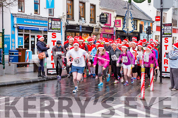 The runners take off at the starts of the Christmas in Killarney 5k on Sunday