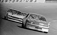 Bill Elliott, #9 Harry Melling Coors Ford , Darrell Waltrip, #17 Rick Hendrick Tide Chevrolet, action, tuen 4, Daytona 500, Daytona International Speedway, Daytona Beach, Florida, February 15, 1987. (Photo by Brian Cleary/www.bcpix.com)