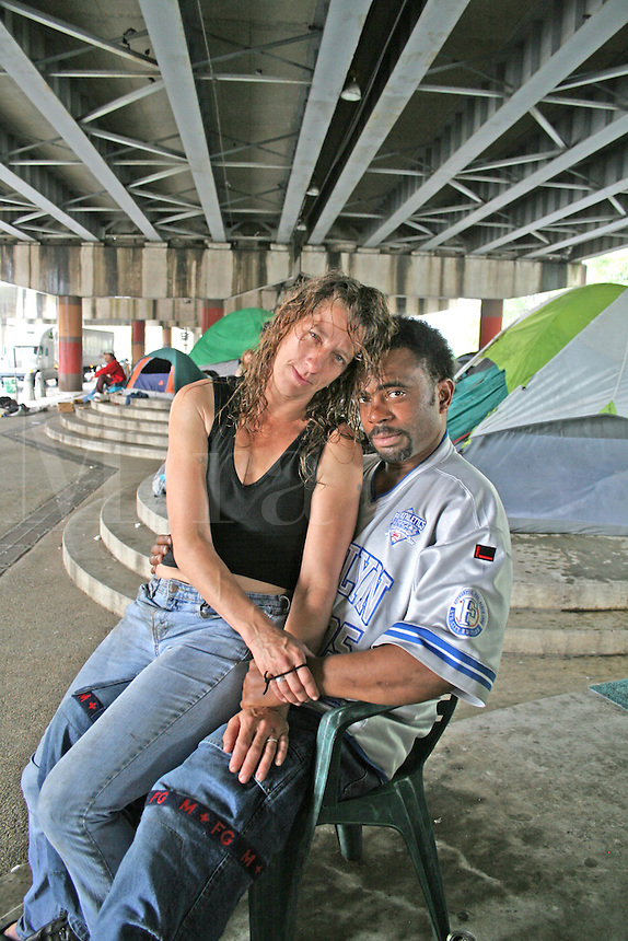 Post Katrina homeless interracial couple under freeway New Orleans Louisiana