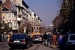 Sofia, Bulgaria. City street with people, a tram, a Mercedes and a Citroen.