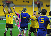 TJ Perenara calls for the ball as referee Mike Fraser yellow cards Aaron Smith during the Super Rugby match between the Hurricanes and Highlanders at Westpac Stadium, Wellington, New Zealand on Saturday, 6 July 2013. Photo: Dave Lintott / lintottphoto.co.nz