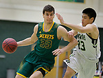 SPEARFISH, SD: NOVEMBER 11:  Stefan Desnica #33 of Black Hills State drives on Harry Sun during their game Saturday at the Donald E. Young Center in Spearfish, S.D.   (Photo by Dick Carlson/Inertia)