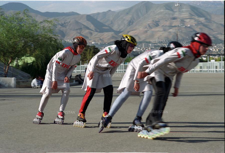 2004..Team members during their practice in Azadi Sports Complex in Tehran...Les membres de l'équipe de patinage pendant un entraînement au complexe sportif Azadi à Téhéran.