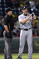 Manager Patrick Osborn (13) of the Charleston RiverDogs argues a call with home plate umpire Matthew Brown in Game 2 of the South Atlantic League Southern Division Playoff against the Greenville Drive on Friday, September 8, 2017, at Fluor Field at the West End in Greenville, South Carolina. Charleston won, 2-1, and the series is tied at one game each. (Tom Priddy/Four Seam Images)