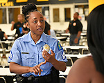 St. Louis Metropolitan Police Sgt. Christy Allen speaks to an attendee at a Diversity Fair sponsored by the St. Louis County branch of the Ethical Society of Police. The fair was held at Hazelwood Central High School on Saturday August 11, 2018 with police agencies from ten different jurisdictions represented.   Photo by Tim Vizer
