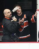 John Furtado (Princeton - Athletic Trainer), Andrew Ammon (Princeton - 14) - The Harvard University Crimson defeated the Princeton University Tigers 3-2 on Friday, January 31, 2014, at the Bright-Landry Hockey Center in Cambridge, Massachusetts.