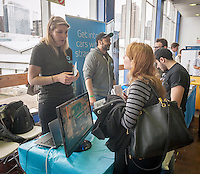 A job seeker speaks with a Via employee at the TechDay New York event on Thursday, April 23, 2015. Thousands attended to seek jobs with the startups and to network with their peers. TechDay bills itself as the world's largest startup event with over 300 exhibitors. (© Richard B. Levine)