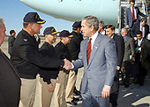 """Naval Station Mayport, Jacksonville, Fla. (Feb. 13, 2003) -- Captain Matthew E. Schellhorn, Commanding Officer, Naval Station Mayport, welcomes President George W. Bush upon his arrival aboard the Naval Station. President Bush later visited with Sailors and their families, thanking them for their sacrifices and the continuing effort with the global war on terror.  """"The United States Navy carries the might and the mission of America to the farthest parts of the world,"""" the President said.<br /> Mandatory Credit: Chuck Hill - US Navy via CNP"""