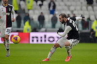 1st December 2019; Allianz Stadium, Turin, Italy; Serie A Football, Juventus versus Sassuolo; Gonzalo Higuain of Juventus passes the ball forward - Editorial Use