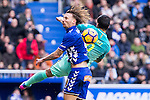 Club Deportivo Alaves'es defender Alexis Ruano competes for the ball with FC Barcelona's forward Luis Suarez  during the match of La Liga between Deportivo Alaves and Futbol Club Barcelona at Mendizorroza Stadium in Vitoria, Spain. February 11, 2017. (ALTERPHOTOS/Rodrigo Jimenez)