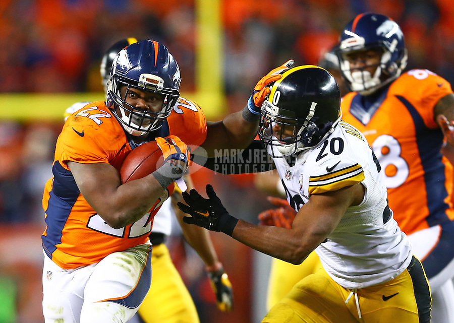 Jan 17, 2016; Denver, CO, USA; Denver Broncos running back C.J. Anderson (22) is pursued by Pittsburgh Steelers safety Will Allen (20) during the AFC Divisional round playoff game at Sports Authority Field at Mile High. Mandatory Credit: Mark J. Rebilas-USA TODAY Sports