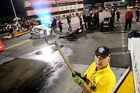 Jul. 29, 2011; Sonoma, CA, USA; NHRA safety safari track prep worker with a blow torch during qualifying for the Fram Autolite Nationals at Infineon Raceway. Mandatory Credit: Mark J. Rebilas-