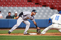 Trenton Thunder third baseman Cito Culver (23) lays the tag on Pat Valaika (10) sliding into third during the first game of a doubleheader against the Hartford Yard Goats on June 1, 2016 at Sen. Thomas J. Dodd Memorial Stadium in Norwich, Connecticut.  Trenton defeated Hartford 4-2.  (Mike Janes/Four Seam Images)