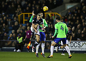 9th February 2018, The Den, London, England; EFL Championship football, Millwall versus Cardiff City; Steve Morison of Millwall lobs the ball over Sean Morrison of Cardiff City with Marko Grujic of Cardiff City putting pressure on