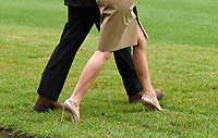 United States President Donald J. Trump walks with first lady Melania Trump prior to their Marine One departure from the White House September 2, 2017 in Washington, DC. The President and first lady are traveling to Texas to visit individuals impacted by Hurricane Harvey. <br /> Credit: Olivier Douliery / Pool via CNP /MediaPunch
