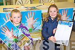 FULL BACKING: Abbie and Matthew Blennerhassett from Ballymac getting behind the G.P.C.E. petition to help bring 5,000 to Kerry at the Manor West shopping centre, Tralee on Saturday..