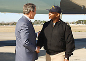 """Naval Station Mayport, Jacksonville, Fla. (Feb. 13, 2003) -- President George W. Bush personally thanks Senior Chief Machinists Mate Arden Battle, stationed aboard the aircraft carrier USS John F. Kennedy (CV 67) for his outstanding community service efforts with local elementary school children, area Special Olympics, and The Salvation Army.  President Bush later visited with Sailors and their families, thanking them for their sacrifices and the continuing effort with the global war on terror.  """"The United States Navy carries the might and the mission of America to the farthest parts of the world,"""" the President said. <br /> Mandatory Credit: Chuck Hill - US Navy via CNP"""