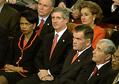 Washington, DC - January 28, 2003 -- Members of the Bush Cabinet and Republican United States Senators listen as United States President George W. Bush delivers his State of the Union Address to a Joint Session of the United States Congress. From left to right: National Security Advisor Condoleezza Rice, White House Chief of Staff Andy Card, Secretary for Homeland Security Tom Ridge, unidentified, and Secretary of Education Rodney Paige.  Behind them, from left are U.S. Senator Jeff Sessions (Republican of Alabama) and Elizabeth Dole (Republican of North Carolina)<br /> Credit: Ron Sachs / CNP