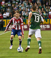 CARSON, CA – June 3, 2011: Chivas USA midfielder Blair Gavin (18) defends Portland Timbers midfielder Jack Jewsbury (13) during the match between Chivas USA and Portland Timbers at the Home Depot Center in Carson, California. Final score Chivas USA 1, Portland Timbers 0.