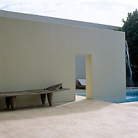 Various outdoor sleeping areas surround the swimming pool