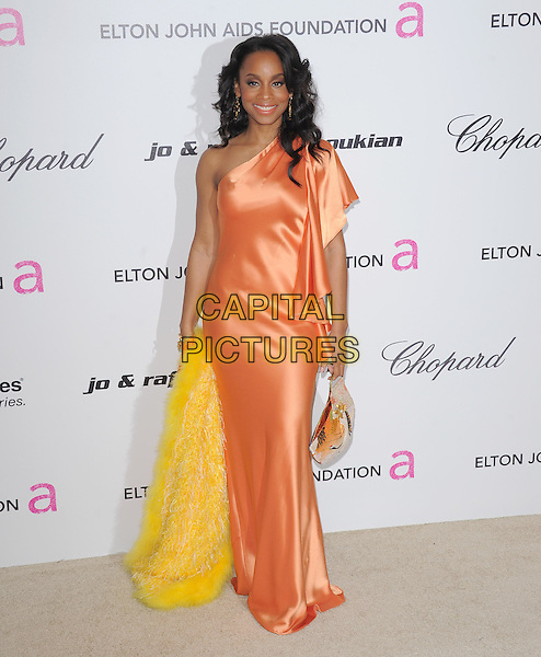 ANIKA NONI ROSE.19th Annual Elton John AIDS Foundation Academy Awards Viewing Party held at The Pacific Design Center, West Hollywood, California, USA..February 27th, 2011.full length pink peach silk satin maxi dress one shoulder yellow fur .CAP/RKE/DVS.©DVS/RockinExposures/Capital Pictures.